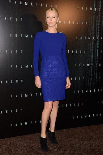 At the Prometheus Paris premiere, Charlize donned a cobalt blue Stella McCartney sheath with black booties.