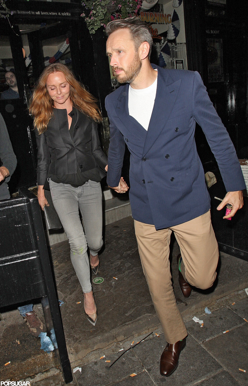 stella mccartney and her husband alasdhair willis joined david beckham