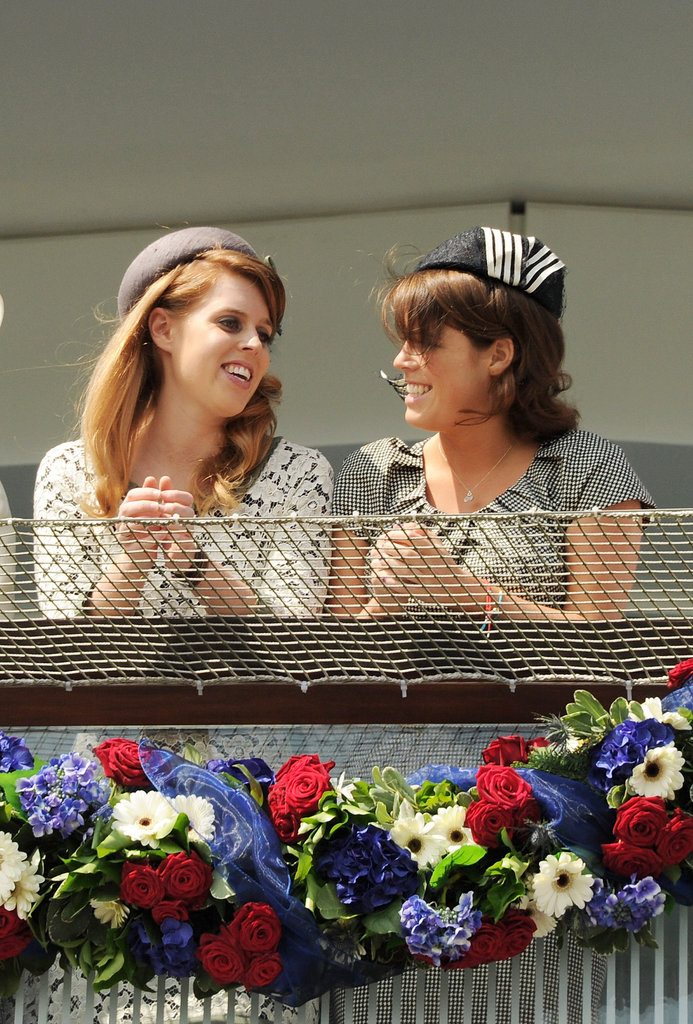 Princesses Beatrice and Eugenie of York chat at the derby.