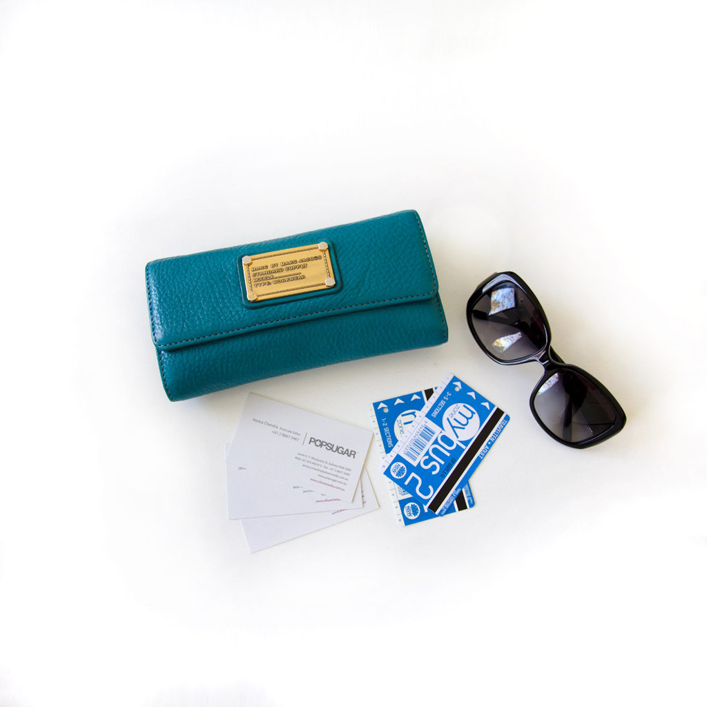 I can't leave the house without these essentials. I bought my wallet in Hawaii last year because I love the colour. I keep my Travel Ten bus tickets in a pouch in my bag for easy access — same with my business cards. And I used to never carry around sunglasses but now I whip them out any time I see the sun!