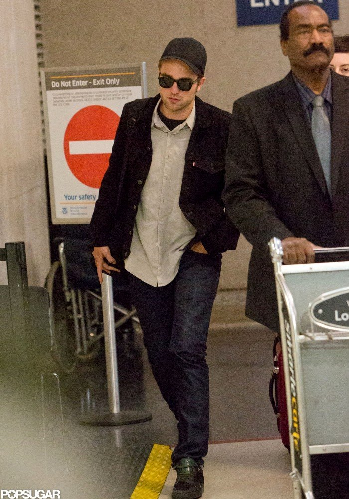 Robert Pattinson got off of a flight at LAX.