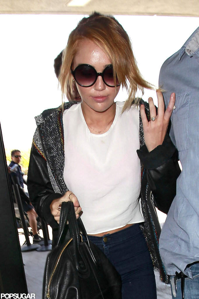 Miley Cyrus gave a peek at her engagement ring at LAX.
