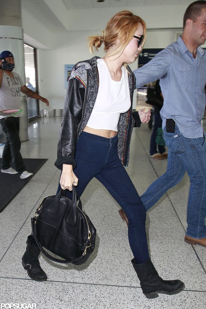 Miley Cyrus was escorted through LAX.