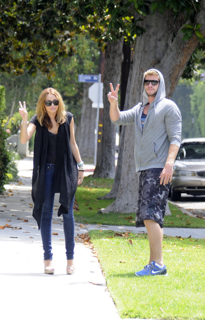 Miley Cyrus and Liam Hemsworth had some fun with photographers in California in July 2010.