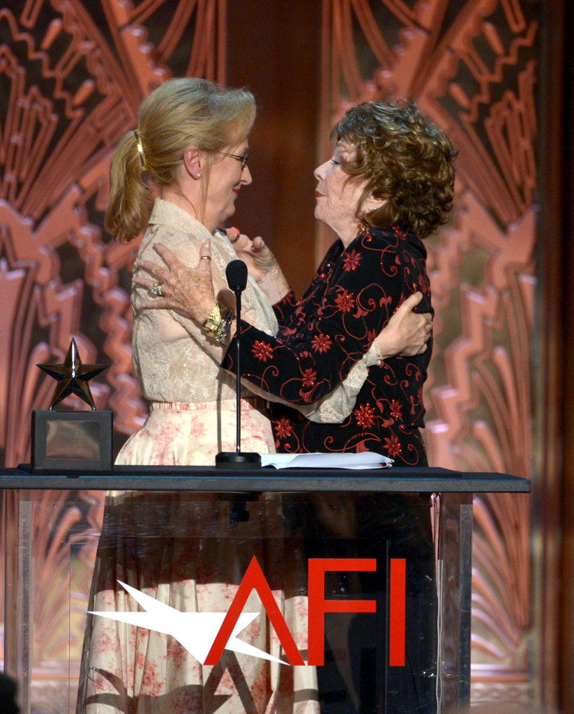 Meryl Streep congratulated Shirley MacLaine onstage at the AFI Life Achievement Award dinner in LA.
