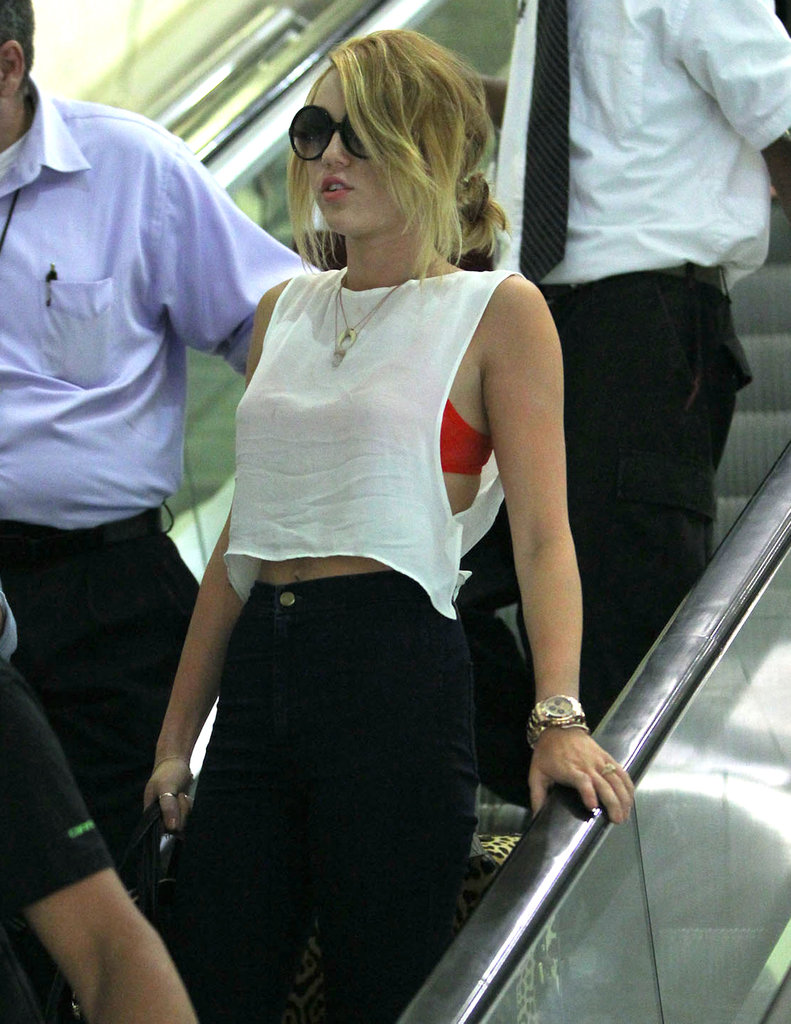 Miley Cyrus sported a white crop top in New Orleans.