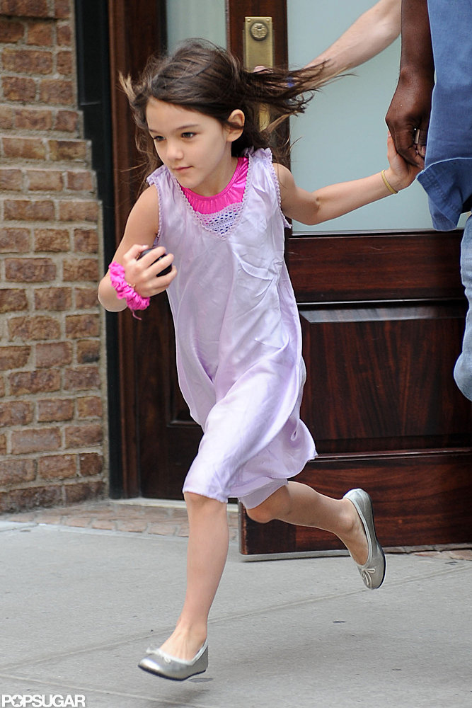 Suri Cruise was on the move as she ran to a car waiting for her.