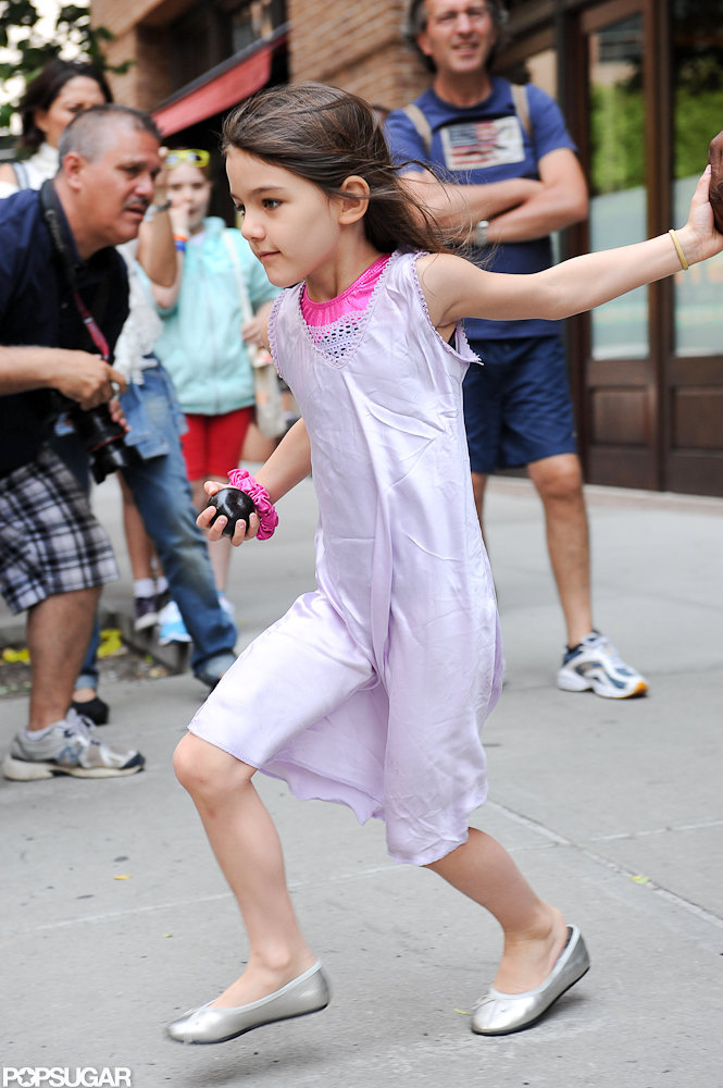 Suri Cruise crossed the sidewalk in NYC.
