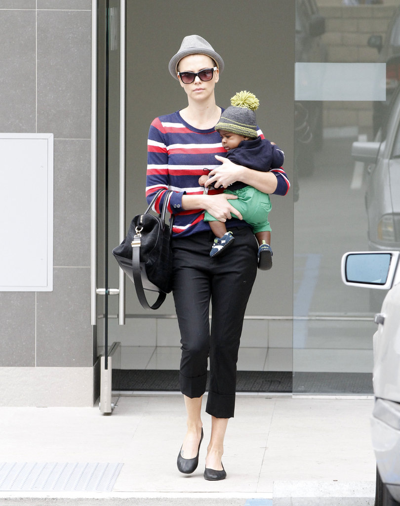 Charlize Theron showed off her legs in black pants while running errands in Beverly Hills.