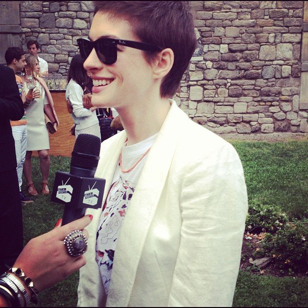Anne Hathaway stopped for interviews at Stella McCartney's presentation. Source: Instagram user netaporter