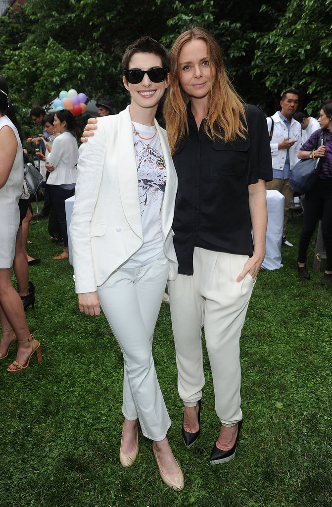 Anne Hathaway posed with Stella McCartney at her presentation in NYC.