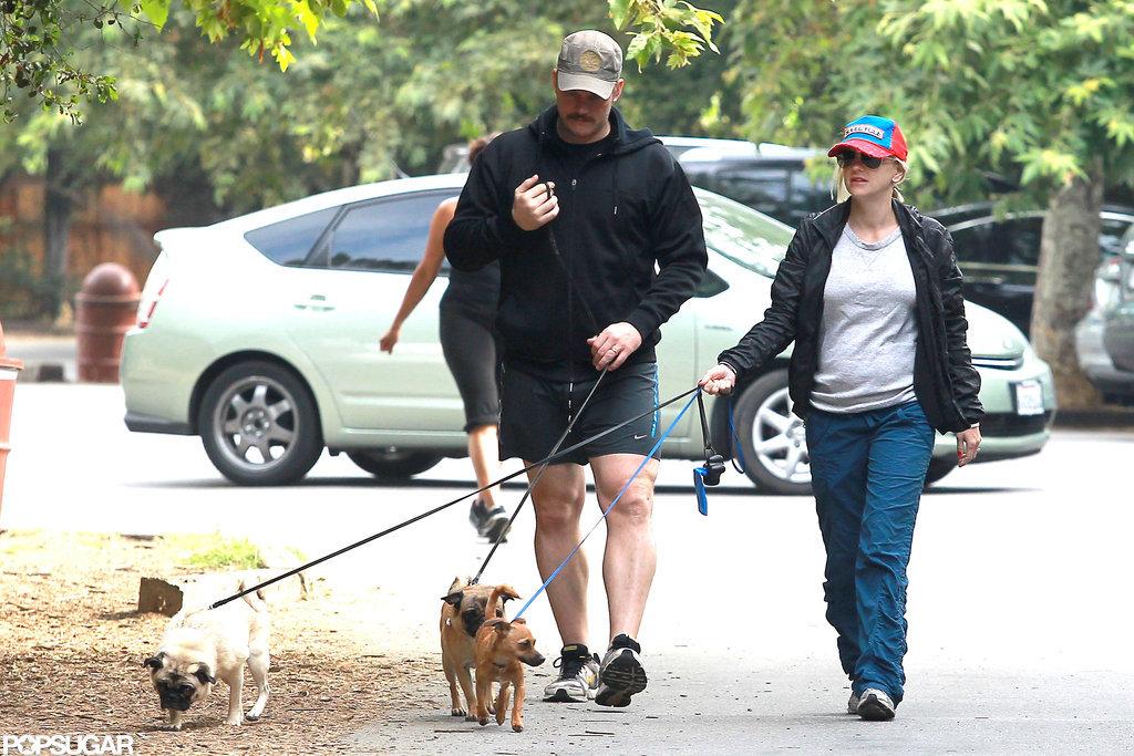 Anna Faris showed off her baby bump as she and Chris Pratt took a walk.