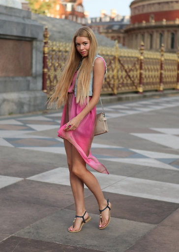 Make a party dress day-appropriate with a denim vest and everyday flat sandals.  Photo courtesy of Lookbook.nu