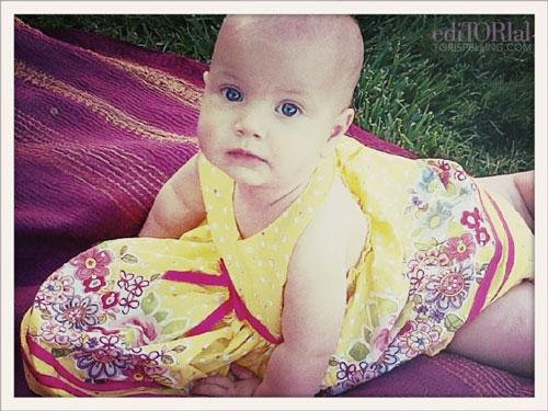 And here's Miss Hattie chilling in the shade on a vintage quilt in a canary-yellow floral Summer frock.