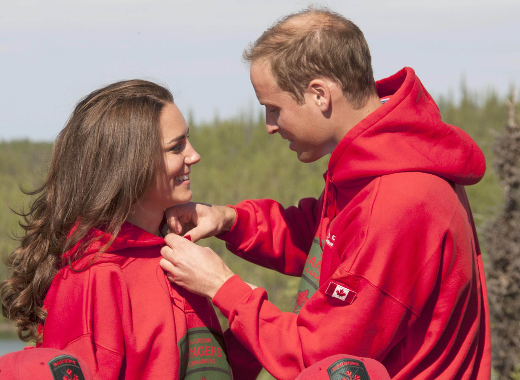William helped Kate adjust her sweatshirt as the two embarked on a Canadian camping trip in July 2011.