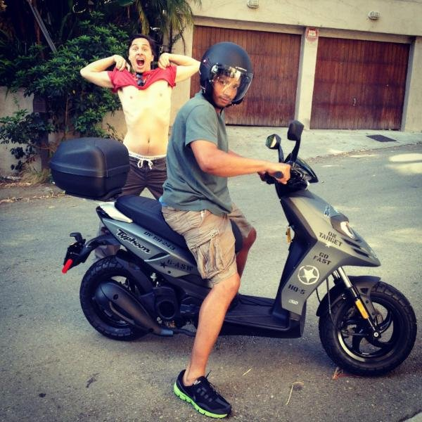 Zach Braff celebrated after gifting his BFF, Donald Faison, with a scooter. Source: Twitter user zachbraff