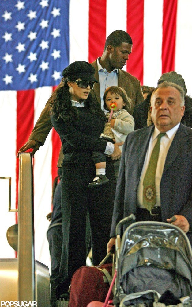 Salma Hayek and Valentina Pinault walked by a big flag at LAX in January 2009.