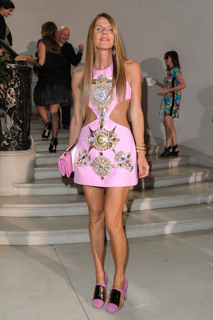 Anna Dello Russo had all eyes on her in a cutout, embellished pink mini and suede heels.