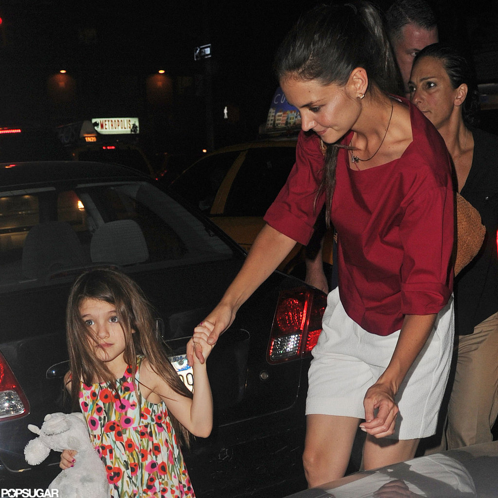 Katie Holmes held Suri's hand after the divorce news.