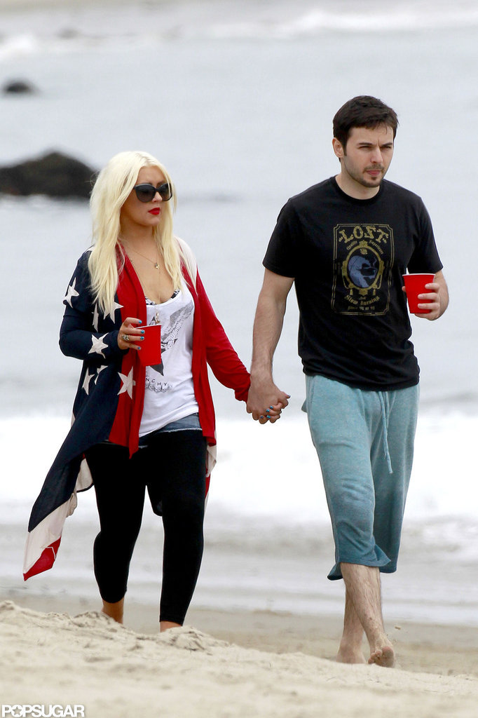 Christina Aguilera and Matthew Rutler walked the beach in Malibu with drinks in hand.