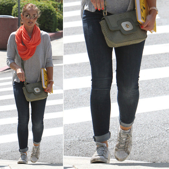 Minka Kelly shows us how to bring some life to our casual look with cool kicks and a bright scarf.