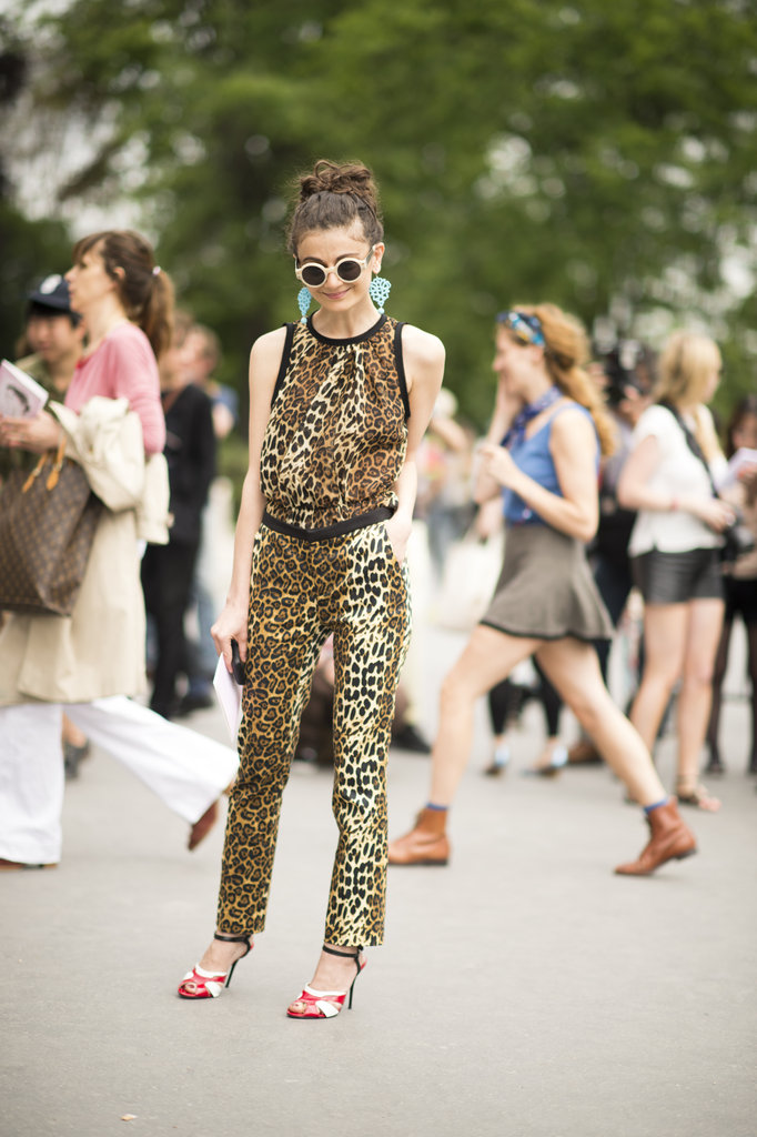 This is the proof that you shouldn't shy away from bold prints or accessories — this leopard-print ensemble only looks cooler with bold jewels and cool shades.