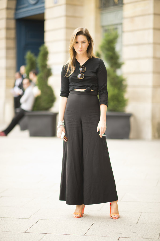 We're obsessed with this black-on-black look. Thanks to flowy high-waist trousers and citrus heels, this look is still decidedly summery. Photo courtesy of Adam Katz Sinding