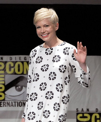 Michelle Williams waved while promoting Oz: The Great and Powerful at Comic-Con.