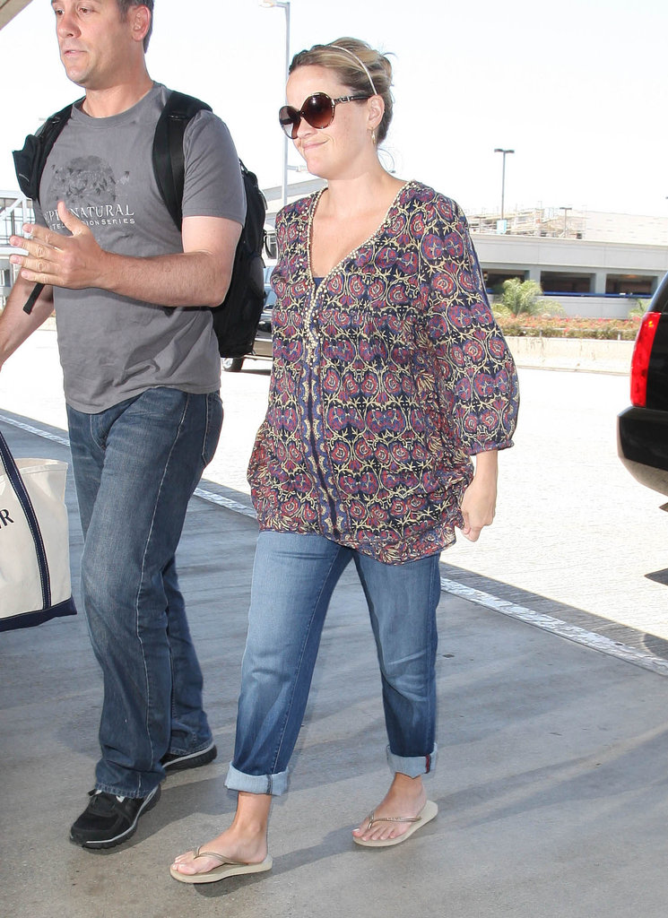 Reese Witherspoon looked cute with her hair pulled back and sunglasses on.