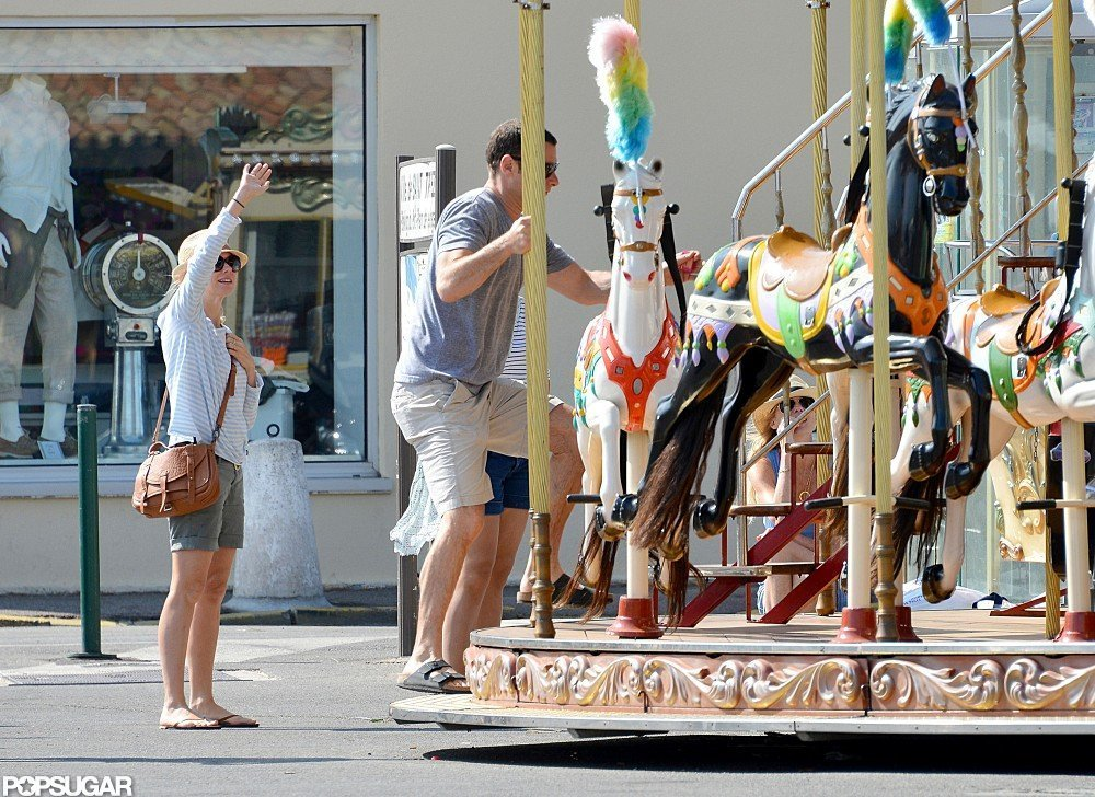 Liev Schreiber hopped on the merry-go-round while Naomi Watts waved.