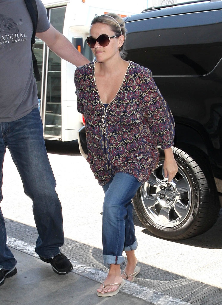 Reese Witherspoon hopped out of an SUV at LAX to catch a flight.