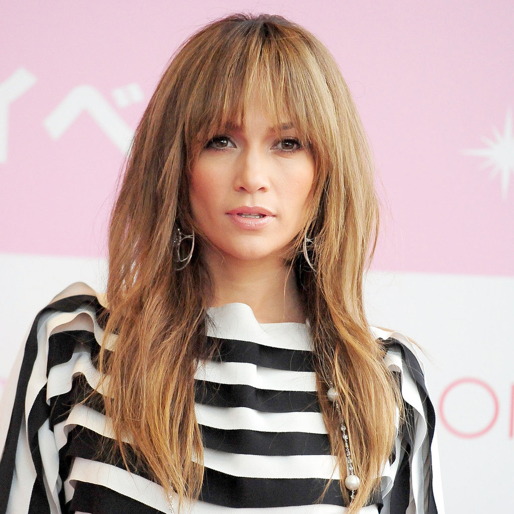 Long hair with bangs and layers for oval face