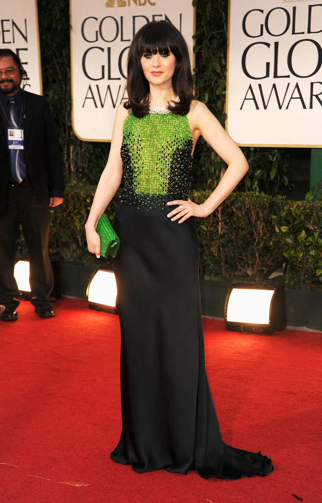 Wearing a green-and-black embellished Prada gown and matching green clutch, Zooey Deschanel channeled retro glamour at the 2012 Golden Globe Awards.