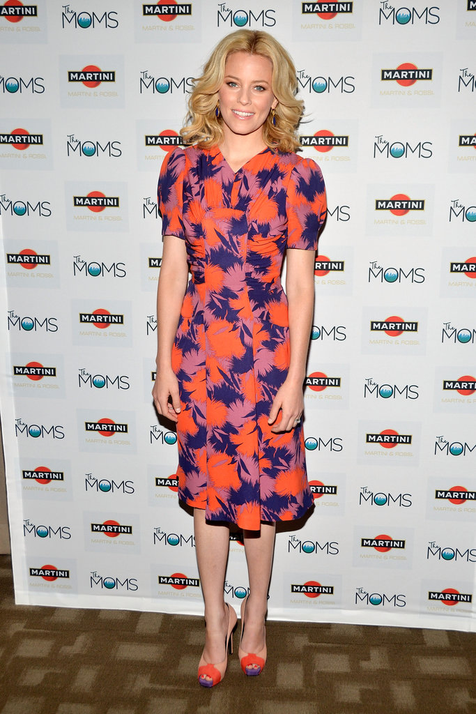 She played up her penchant for bright colours and bold prints in this Summer-perfect Jill Stuart dress and colour-blocked Barbara Bui heels.
