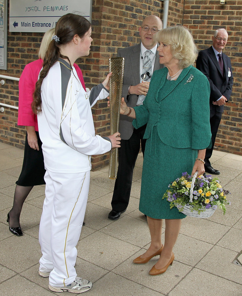 Camilla, Duchess of Cornwall, examined the Olympic torch while meeting a paralympic athlete on July 10.