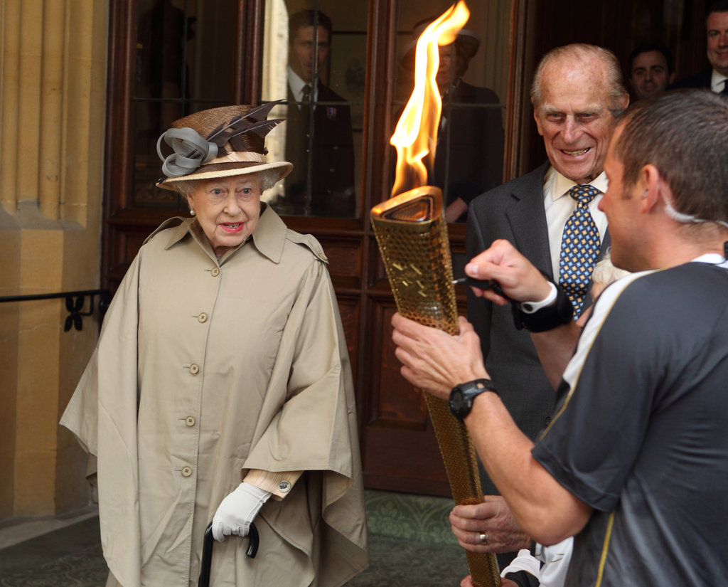 The queen and her husband, Prince Philip, welcomed the Olympic torch to Windsor Castle.