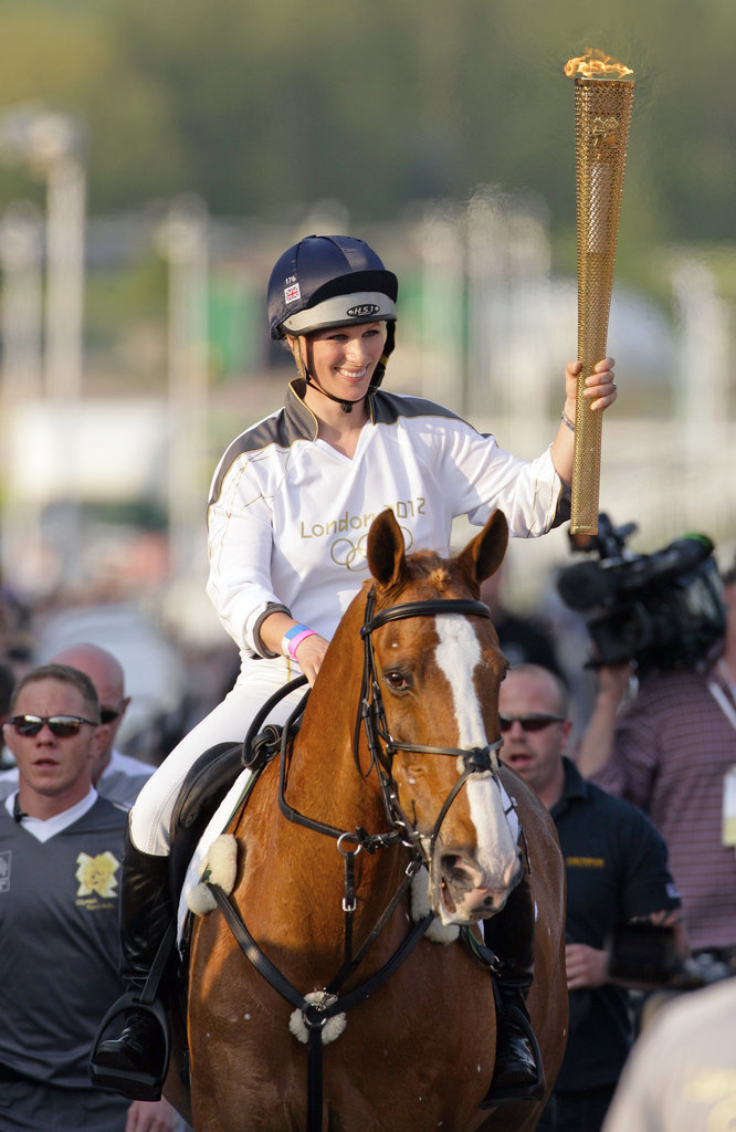 Zara Phillips carried the Olympic torch while riding her horse Toytown.