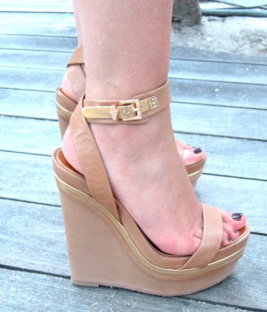 Sky-high nude wedges finish off the look.