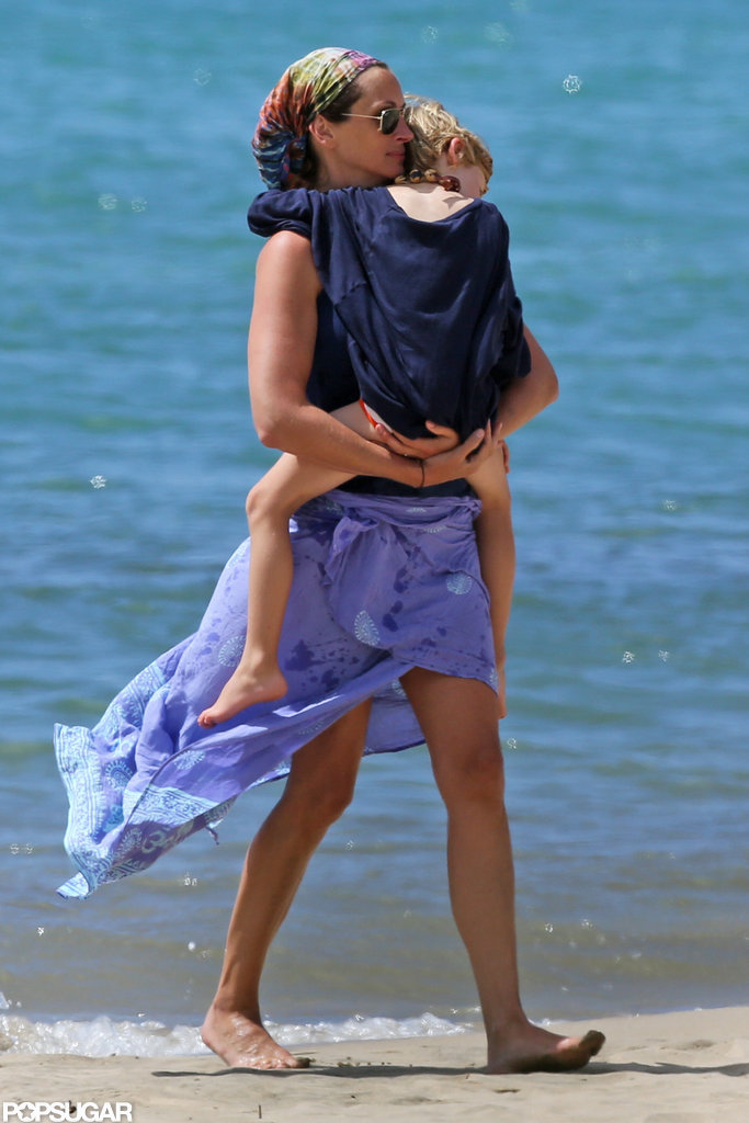 Julia Roberts carried one of her children in Hawaii.