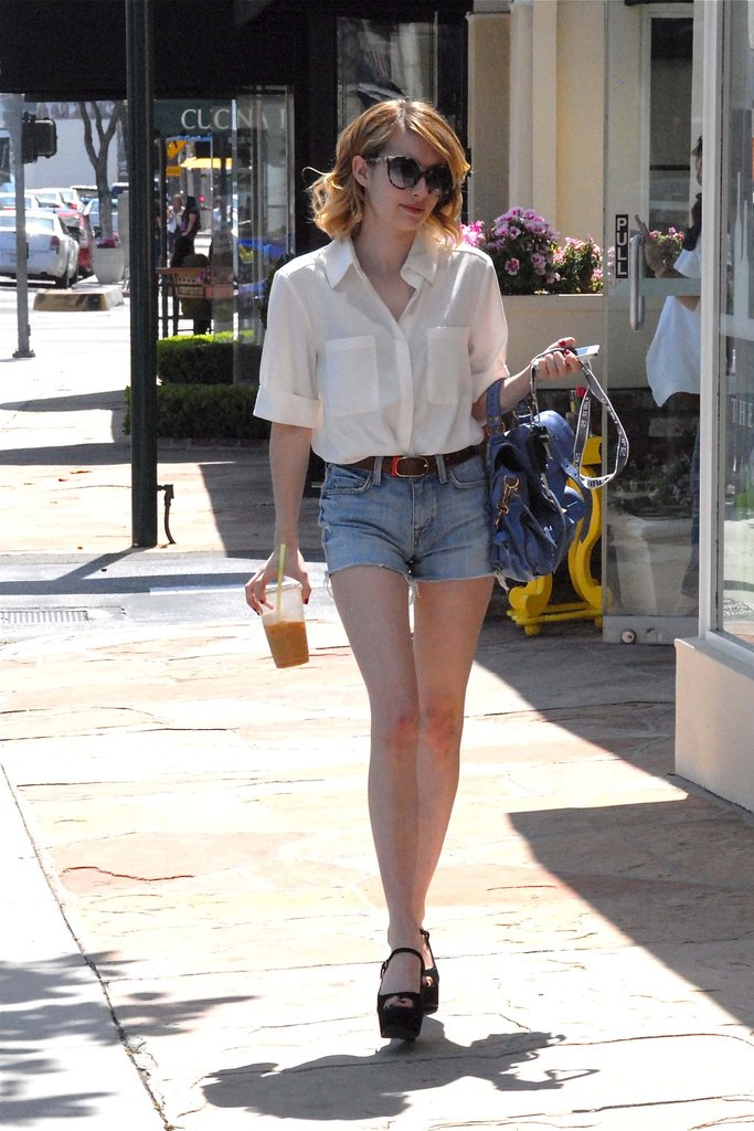 Emma Roberts did her part to keep cool with a lightweight button-up and high-waisted cutoffs.