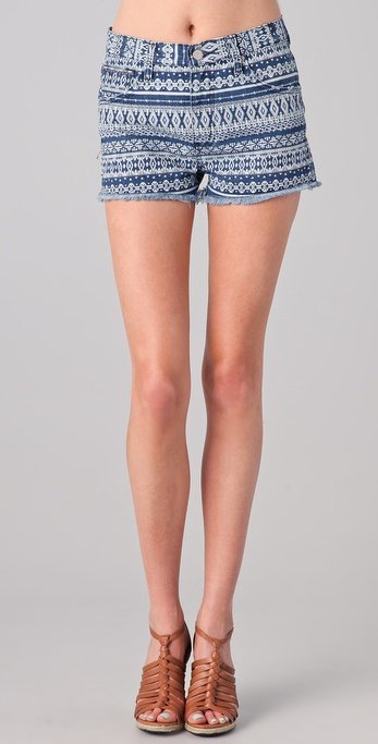 Have another Summer concert on the docket? Style this tribal-printed short with a slouchy white t-shirt and gladiator sandals for the complete music-festival vibe. Washborn Geometric Print Denim Shorts ($31, originally $104)