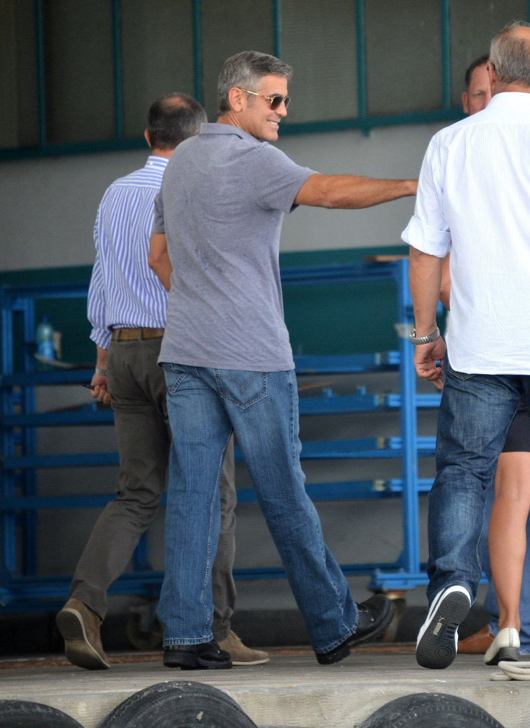 George Clooney greeted the crew on his commercial in Italy with smiles last month.