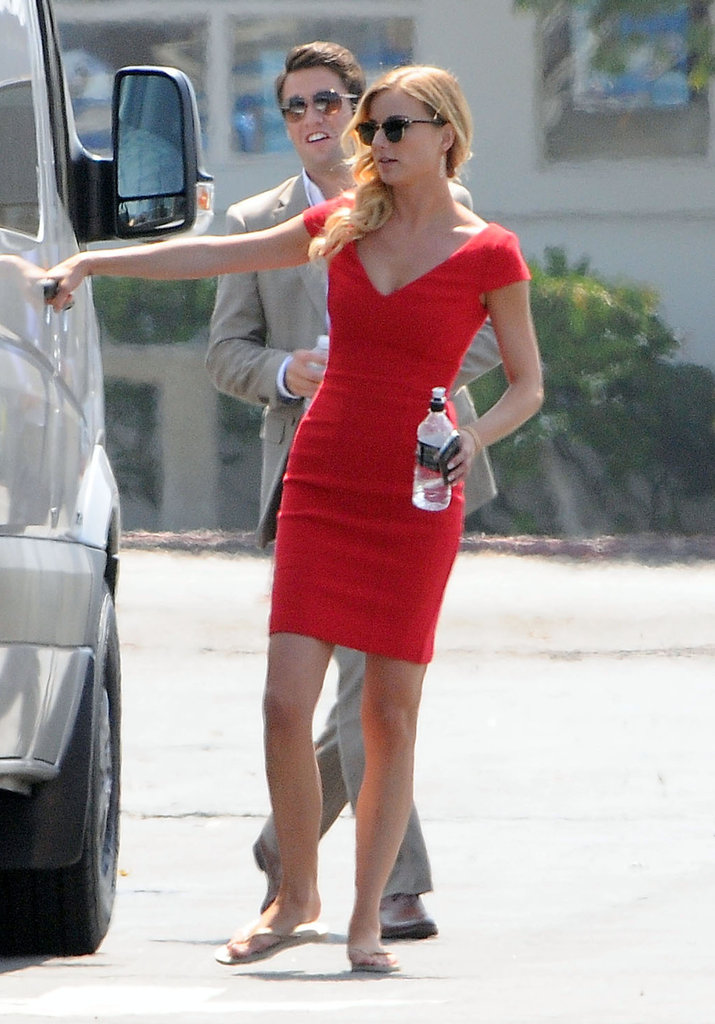Emily VanCamp and Josh Bowman were dressed up on set.