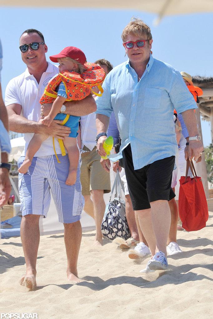 Elton John, David Furnish, and Zachary Furnish-John hit the beach.