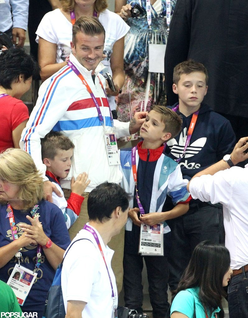 David Beckham, Cruz, Romeo, and Brooklyn watched the action at the Olympic London Aquatics Centre in Summer 2012.