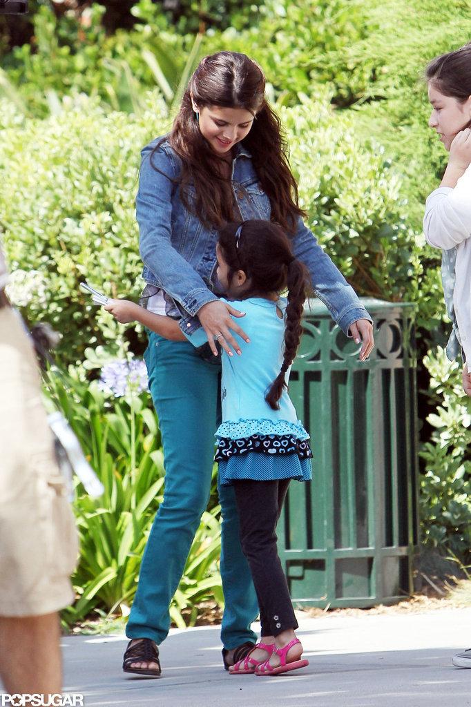 Selena Gomez hugged a younger girl on set.