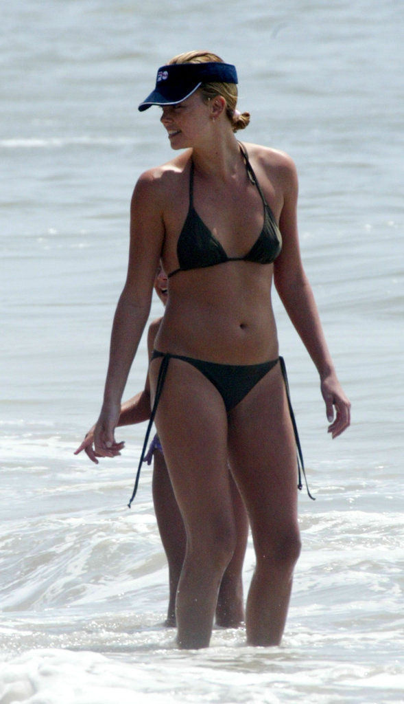 In August 2003, Charlize wore a bikini to the beach in Malibu.