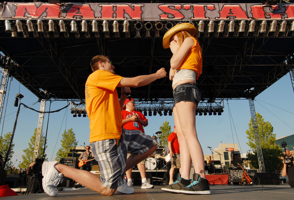 A festivalgoer proposed on the stage at the Downtown Hoedown at Comerica Park in Detroit.