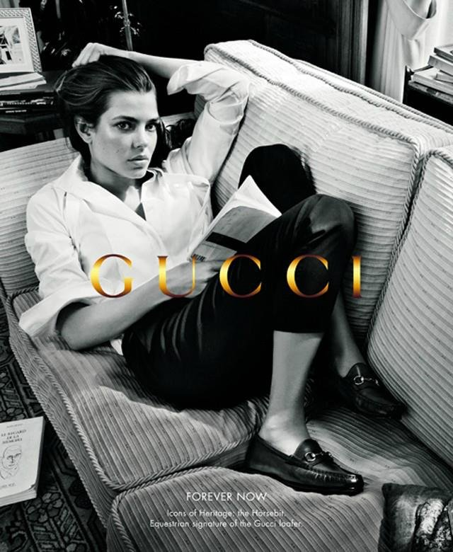Charlotte totally nails the borrowed-from-the-boys look while lounging in Gucci's Forever Now Fall ad campaign.