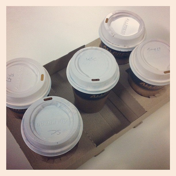 This is a regular sight in the office — nothing gets done unless we have our 7am coffees on hand! We even have a roster for who's buying each day...